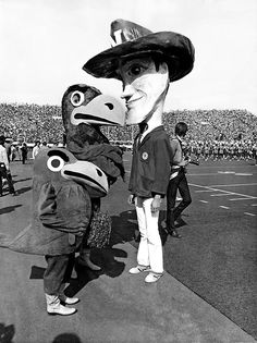 The caricature mascots of Nebraska and Kansas huddled during a game at Memorial Stadium on Oct. 16, 1971. The Huskers ran away with the game 55-0. THE WORLD-HERALD