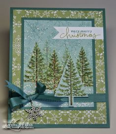Sparkling Festival of Trees. I created the scene by stamping my little pine forest on Soft Sky cardstock. I added snowflakes from Endless Wishes stamp set with the coordinating ink. For some pretty sparkle I painted over the entire thing with Dazzling Details.