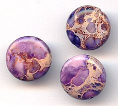 37607  Purple Impression Jasper Puff Coins, 6  Lovely in lilac, our Purple Impression Jasper gemstones are truly one of a kind.  With shades of deep plum, light lavender, and vibrant violet, these smooth puff coins feature an elaborate warm chestnut and burnt umber crackling pattern and are drilled from top to bottom at the longest point. Combine them with green and blue beads for an eye catching peacock effect.