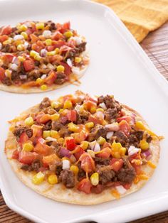 @Cosmopolitan Low Cal Mexican Pizza - 1 low-carb tortilla, ¼ c. marinara sauce, 1 oz. lite shredded cheese, and ¼ c. thinly sliced red onions.   Spread sauce onto tortilla, add cheese and onions on top and bake in toaster oven at 350° for 5-7 minutes.   175 calories