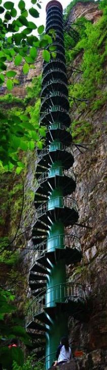 """Stairway to heaven: 300ft spiral staircase to give Chinese tourists a taste of the high life • """"The 300ft spiral staircase has been installed on the wall of the Taihang Mountains in Linzhou, [Henan, China] to offer the thrill of mountaineering without the danger."""" • by Sara Malm • photo: CEN"""