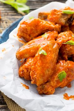 Oven baked buffalo chicken wings take al little time to make, but once you smother them in sauce they are worth all the effort!