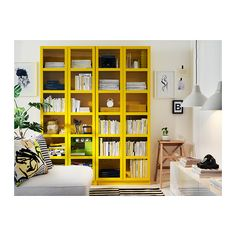 Yellow IKEA Billy bookcases with doors.