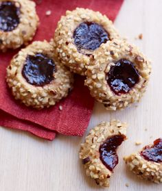 Linzer tarts are a festive addition to any holiday table, but they take time—so skip the effort and go with these little cookies, which require no rolling and a quick push of your thumb to create the center. #dessert #recipe #holidays