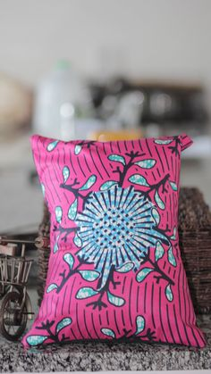 Pink African fabric accent pillow cover. $20.00, via Etsy.