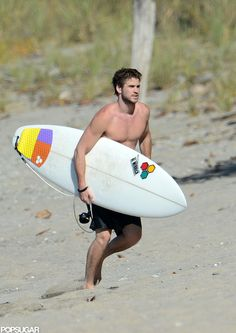 Exclusive Pictures — #LiamHemsworth walked on the beach #shirtless.