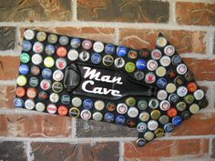 Man Cave Sign Beer Bottle Caps Mosaic with Melted Beer Bottle.