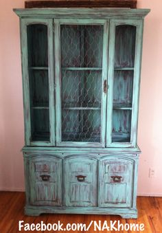 Furniture makeover: Old hutch with broken glass door replaced with chicken wire and painted with homemade turquoise chalk paint