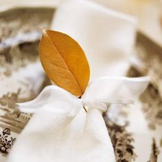 Nature's Napkin Rings  A simple but delightful touch comes in the form of one small leaf. Find wonderfully colored little leaves to tie onto napkins for family dinners and dinner parties