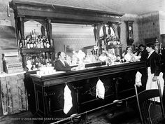 A waiter and bartenders are seen in the Garibaldi Saloon at 20 Monroe Ave., Detroit, circa 1898. (Detroit News archives)