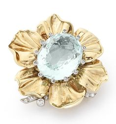An aquamarine and diamond flower clip, by Cartier, circa 1950  The oval-cut aquamarine within a single-cut diamond claw setting, surrounded by polished petals, with brilliant, baguette and single-cut diamond foliate detail, aquamarine approximately 29.50 carats, signed Cartier London, length 4.7cm