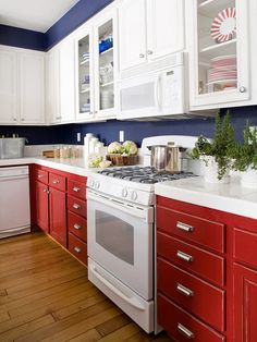 red kitchen, blue walls, color, red white blue, blue kitchens, kitchen ideas, kitchen counter, white cabinets, cabinet hardware
