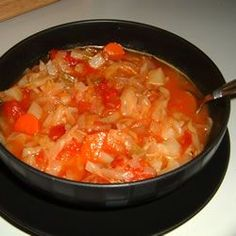 Cabbage Fat-Burning Soup  Ingredients  2-3/4 carrots, chopped  1-1/2 onions, chopped  1 (16 ounce) cans whole peeled tomatoes, with liquid  1/2 large head cabbage, chopped  1/2 (1 ounce) envelope dry onion soup mix  1/2 (15 ounce) can cut green beans, drained  4-1/4 cups tomato juice  1 green bell peppers, diced  5-1/4 stalks celery, chopped  1/2 (14 ounce) can beef broth  Place carrots, onions, tomatoes, cabbage, green beans, peppers, and celery in a large pot. Add onion soup mix, tomato juice, beef broth, and enough water to cover vegetables. Simmer until vegetables are tender. May be stored in the refrigerator for several days. Serves 8  http://allrecipes.com
