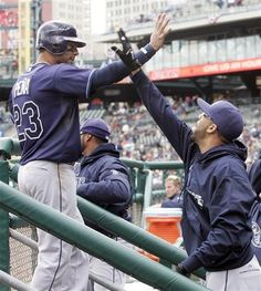 Carlos Pena heads for the dugout after scoring the game winning run vs Tigers 04/11/12