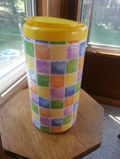 Old Clorox wipe containers - scrapbook paper and modge podge!