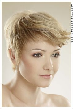 Hair Style: This is a cute pixie hairstyle a the hair is layered short. The hair at the sides and forehead have been brought forward. The bangs are nicely set at front and the overall look is young and fun.  Hair Cut: The hair has been cut short.  Hair Colour: This hair colouring is medium blonde.