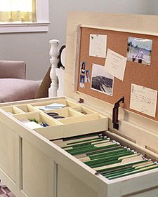 Office in a Trunk.  If you're REALLY stuck for space, this is a neat idea. Put the chest in your living/sitting area and use the top part as a coffee table when company is over. When you need to work, open it up and reveal your desk. Organize bills, receipts, important docs... photo's.. even scrapbooking paper.