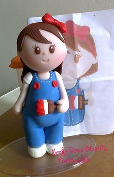 Doll cake topper .