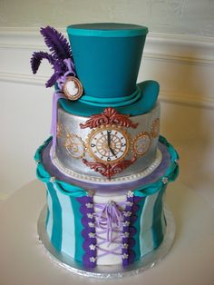 """Steampunk Victoriana cake designed and created by Veronica Arthur. The hat, cameo, feathers, ribbon are made with gumpaste. Excuse the """"spar..."""