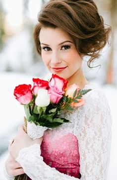 winter wedding with red and pink rose bouquet