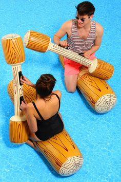 swimming pool battle with inflatable logs