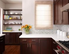 open shelving. glass tiles. white counters