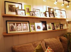 photos over couch - love the tongue and groove board with the plain shelf and photos