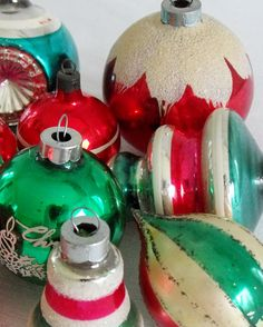 Beautiful vintage glass ornaments in reds and greens.