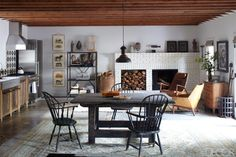 A Peek Inside Ellen and Portia's Eight-Cabin Horse Estate - The Printed Page - Curbed National ** Perfect Blend of Farmhouse Chic, Rustic & Modern Design -- Love this eat in kitchen!