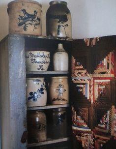 Old Cupboard...prim salt glazed crocks & quilt.
