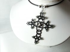 tatted cross pendant