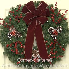 Deluxe Traditional Christmas Wreath with Lights - 2013 - Our Deluxe Traditional Christmas Wreath is made of a full artificial pine wreath base decorated with pine cones, red berries, incandescent lights and is finished with a lovely over-sized Burgundy bow. It will add a touch of old fashioned Holiday charm! The lights plug directly into the outlet (no need for constantly changing batteries!). - #ArtificialChristmasWreaths #ChristmasWreaths #Wreaths #Wreath #LightedChristmasWreaths