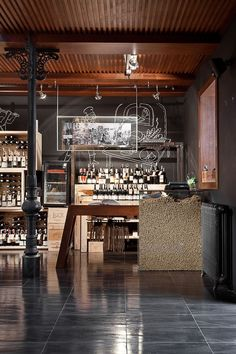 Stefano's Fine Food Factory (Store) by YOD Design Lab , via Behance - bar - glass shelves against chalkboard painted wall - old wood bar in front - stools (or not)