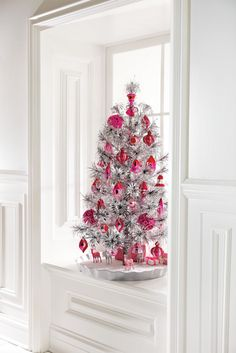 #christmas trees #home decor #style #holidays - Furniture and Accessories. Amazing Silver Tinsel Christmas Tree with Bright Red and Pink Ornaments.