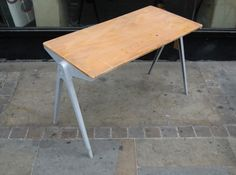 Compass' stacking side table. James W. Leonard for Esavian Ltd, Education Supply Association, Stevenage. 1948.  Painted die cast aluminium legs with plywood top and polythene ferrules. The 'Education supply association' was the trade name used by Esavian Ltd for the production of low cost, good quality school furniture.