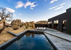 "This all-black house in the Yucca Valley desert was designed by Los Angeles office Oller & Pejic to look ""like a shadow"""