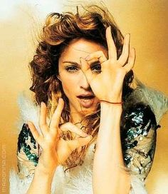 Madonna Imagery: double a-ok 666 hand sign, one eye symbolism