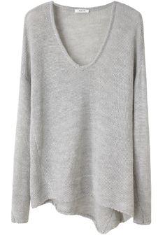 Drapey feminine sweater. Reminds me a little of the matrix