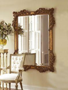 Hand carved rectangular mirror in burnished antique gold, Acanthus leaf motif. Beveled.