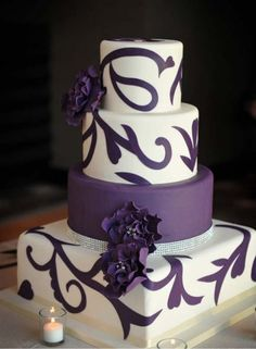 4 tier purple wedding cake with a square bottom