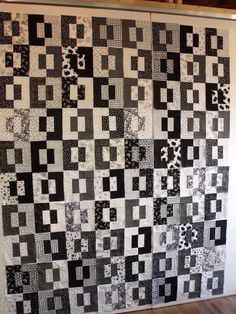 Black and white jelly roll quilt, Split Decision, posted at Treadle Quilts: Nick and Christina's quilt