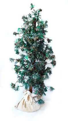 needley pine tree DIY from Anthropologie posted on Apartment Therapy - two other tree crafts posted as well
