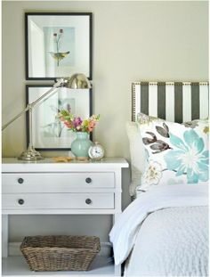 I love this idea! White bed spread, floral pillow shams...I would change the stripes on the headboard to a chevron print. Chic!