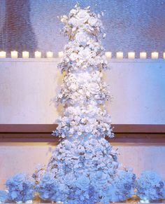 """We LOVE Sylvia Weinstock's Wow-Worthy Wedding Cakes - BUTTERCREAM DREAMS What do you create for the family of a premier N.Y.C. chef? A cake with the most popular flavor selection: yellow cake with lemon/raspberry fillings! And Weinstock notes that all of her icing is Italian butter creme (according to her, """"fondant is never used on a true Weinstock cake!""""). #InStyle"""