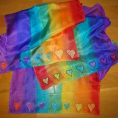Chakra silk scarf handpainted with the seven main chakra colours. Gold hearts or silver hearts.
