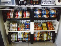 """I would of never thought to use bins to store canned goods this way- what an idea! """"Pantry organization:  I repurposed stacking bins that had been in the basement forever for organizing canned goods."""""""