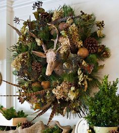 Pheasantly Surprised: Dried hydrangeas and pheasant feathers add fall flair to this charming mantel display. Start by purchasing a standard faux-pine wreath, and scatter the seasonal elements throughout. Place the bold arrangement around an existing piece of decor, such as this wooden deer head, to create a festive and fun focal point