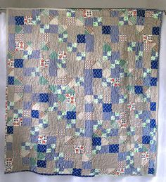 Pretty soft blue and gray quilt.