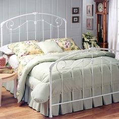 Iron bed frame. Love these!