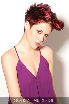 This short textured cut that defies gravity is amplified with burgundy hues, which add the perfect accent to this multi-dimensional look.